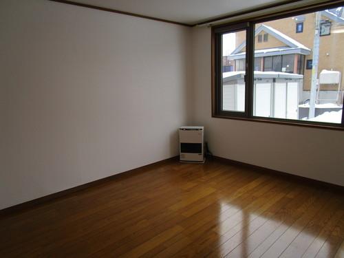 エクセレント橘102号室 居間 (7).JPG